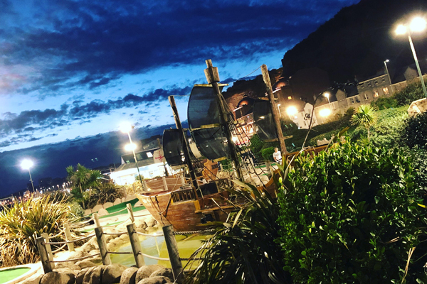 Hastings Adventure golf Pirate boats lit up at night