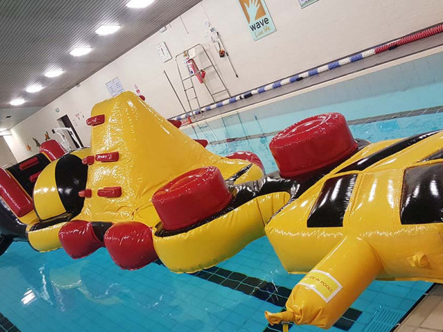 Giant inflatable assault course floating in a pool