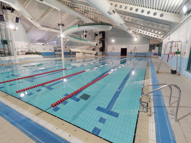 inside Lewes leisure centre pool. It has a pool with lanes in and a long curly slide