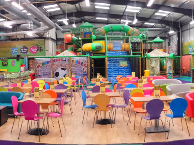 Inside monkey bizness, it shows the seating area and an overview of the soft play