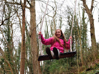 Girl on giant swing at Groombridge Place