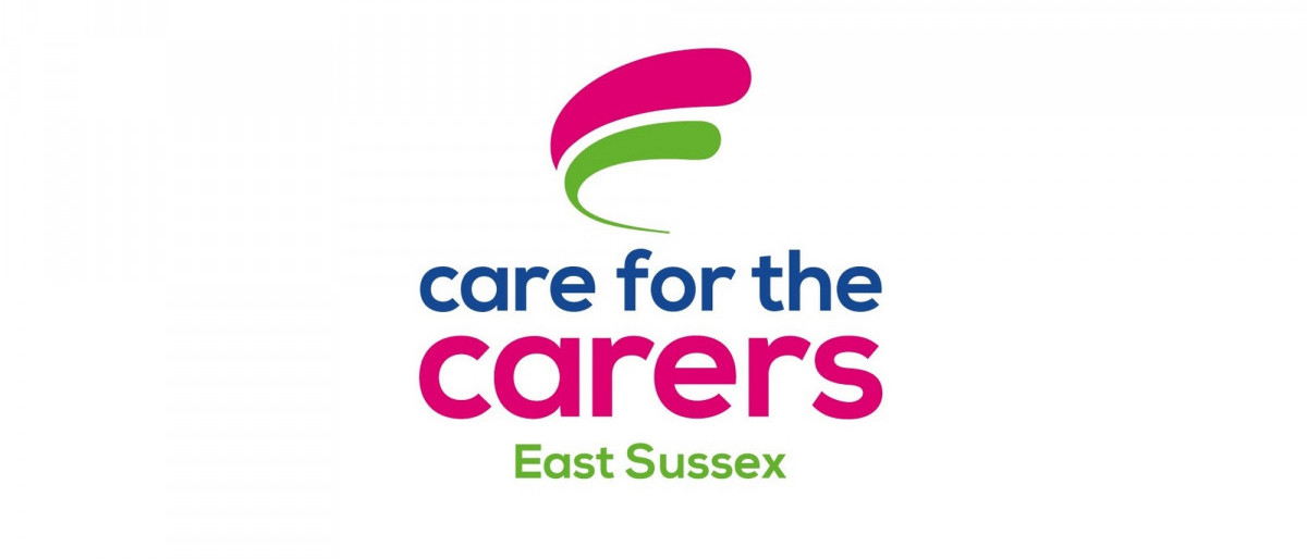 Care for the Carers logo in words of pink, green and blue