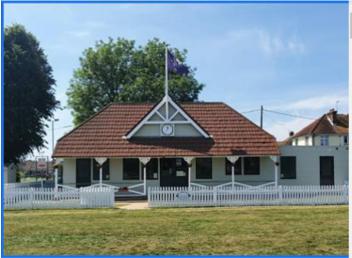 Hailsham pavilion cricket club with white picket fence