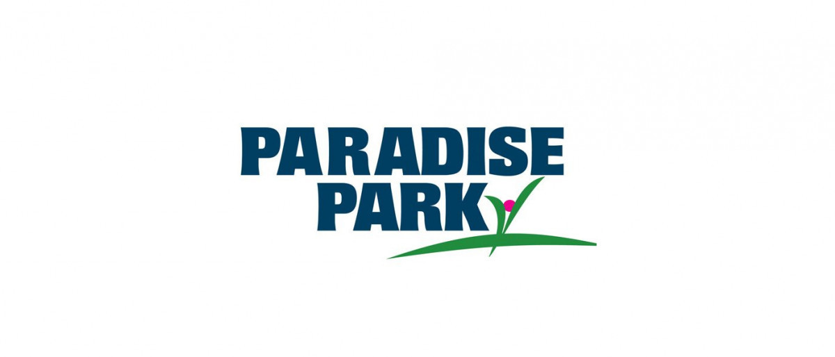 Paradise Park logo with blue writing and a flower